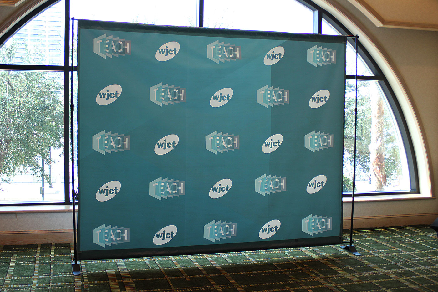 TEACH Conference step-and-repeat photo backdrop